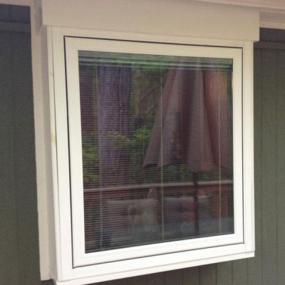 white projected frame window with blinds exterior