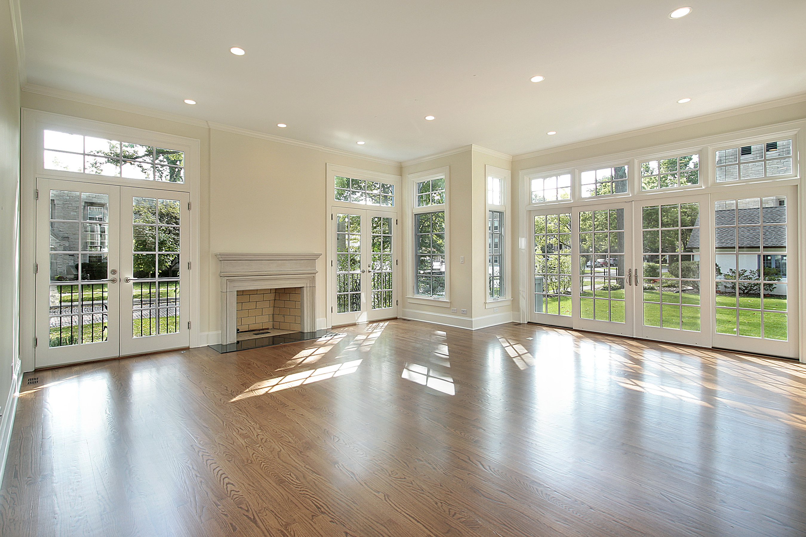windows_white_room_hardwood_floors_fireplace_Joesfav_Depositphotos_8682707_original
